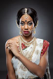Young Indian woman in traditional clothing with bridal makeup and jewelry Stock Photos