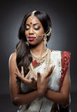 Young Indian woman in traditional clothing with bridal makeup and jewelry Stock Photo