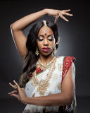 Young Indian woman in traditional clothing with bridal makeup and jewelry Stock Image