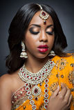 Young Indian woman in traditional clothing with bridal makeup and jewelry Royalty Free Stock Photo