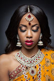 Young Indian woman in traditional clothing with bridal makeup and jewelry Royalty Free Stock Photography