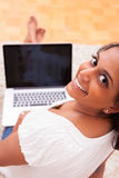 Young indian woman using a laptop Royalty Free Stock Photos