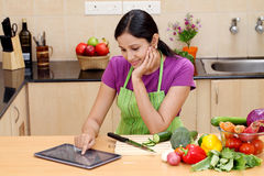 Young Indian woman using a tablet Stock Photos