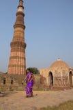 Young indian woman walking near Alai gate, Qutub Minar, Delhi, I Royalty Free Stock Image