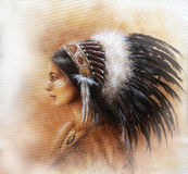 Young indian woman wearing a big feather headdress, a profile p Royalty Free Stock Image