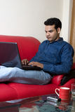 Young indian working from home Stock Photos