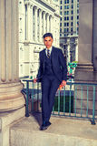 Young Indonesian American Businessman in New York. Indonesian American Businessman Working in New York. Wearing black suit, patterned necktie, vest, leather Stock Images