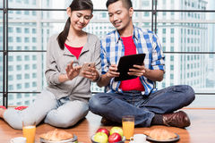Young indonesian couple having breakfast Royalty Free Stock Photography