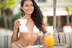 Young Indonesian woman in tropical resort Stock Photo