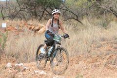 Young Inian girl riding through bush at Mathaithai Mountain Bike Royalty Free Stock Images