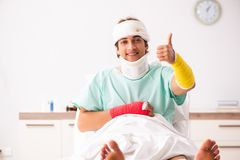 The young injured man staying in the hospital. Young injured man staying in the hospital royalty free stock photo