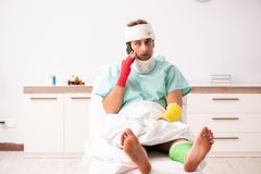 The young injured man staying in the hospital. Young injured man staying in the hospital royalty free stock photos