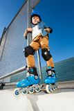 Young inline skater in helmet posing at skate park Royalty Free Stock Images