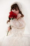 Young innocent 4 year old toddler. Holding flowers Royalty Free Stock Photography