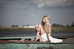 A young innocent girl at the lake. In traditional Russian dress Stock Photos