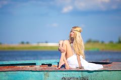 A young innocent girl at the lake. In traditional Russian dress Royalty Free Stock Image