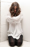 Young insane woman with straitjacket on knees Royalty Free Stock Photo