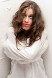 Young insane woman with straitjacket looking up. Camera close-up portrait stock photography