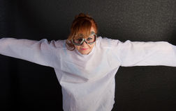 Young insane woman with straitjacket with pilot glasses Stock Photos