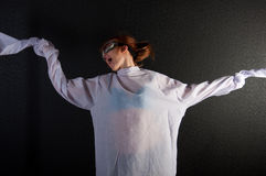 Young insane woman with straitjacket with pilot glasses Stock Image