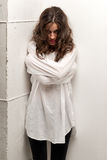 Young insane woman with straitjacket standing Royalty Free Stock Photography