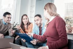 Young interested people working and focusing on the document. Royalty Free Stock Images