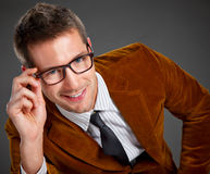 Young interesting businessman with rimmed glasses Royalty Free Stock Photos