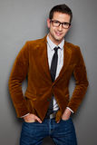 Young interesting businessman with rimmed glasses. Portrait of attractive businessman on grey background Stock Photography