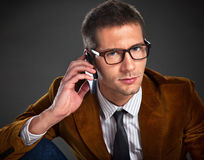 Young interesting businessman talking on phone Royalty Free Stock Images