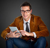 Young interesting businessman touching a screen tablet Royalty Free Stock Photo