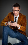 Young interesting businessman touching smartphone Stock Photography