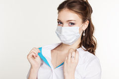 Young intern is wearing medicine face shield Stock Image