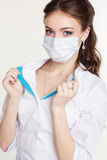 Young intern is wearing white medicine face shield Stock Images