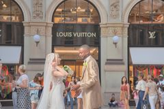 Wedding day in Galleria Vittorio Emanuele royalty free stock image