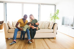 Young interracial family with little children at home. Stock Images