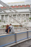 Young Intimate Couple Talking on Cavenagh Bridge Royalty Free Stock Photography