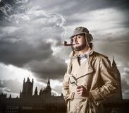 Young investigator in London. Young handsome investigator in London royalty free stock photos