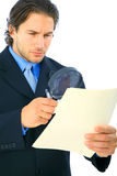 Young Investigator Looking At Folder Royalty Free Stock Photos