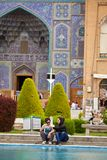 Young Iranian lovers on a date near mosque, Isfahan, Iran. Royalty Free Stock Photo