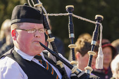 Young Irish man playing the bagpipe Royalty Free Stock Photography