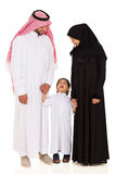 Young islamic family. Lovely young islamic family standing on white background Stock Photography