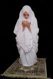 Young islamic girl wearing hijab and pray Stock Photo