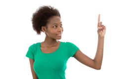 Young isolated afro american teenager is showing something. Royalty Free Stock Photos
