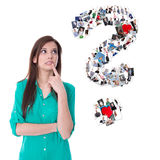 Young isolated woman with question mark. Concept for a dating po Royalty Free Stock Photo