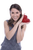 Young isolated woman with a red heart for valentines day Royalty Free Stock Photography