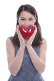 Young isolated woman with a red heart for valentines day Royalty Free Stock Photos