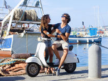 Young Italian Couple on Scooter Stock Images