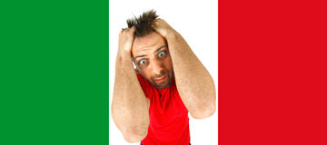 Young Italian desperate in the Italian flag. Stock Photo