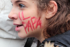Young Italian Faithful With  The Pope  Written On The Cheek Royalty Free Stock Photos