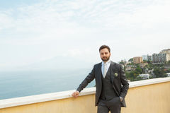 Young Italian groom before marriage in Sorrento peninsula. Young Italian groom with beard, brown hair and green eyes before marriage in Sorrento peninsula Royalty Free Stock Photos
